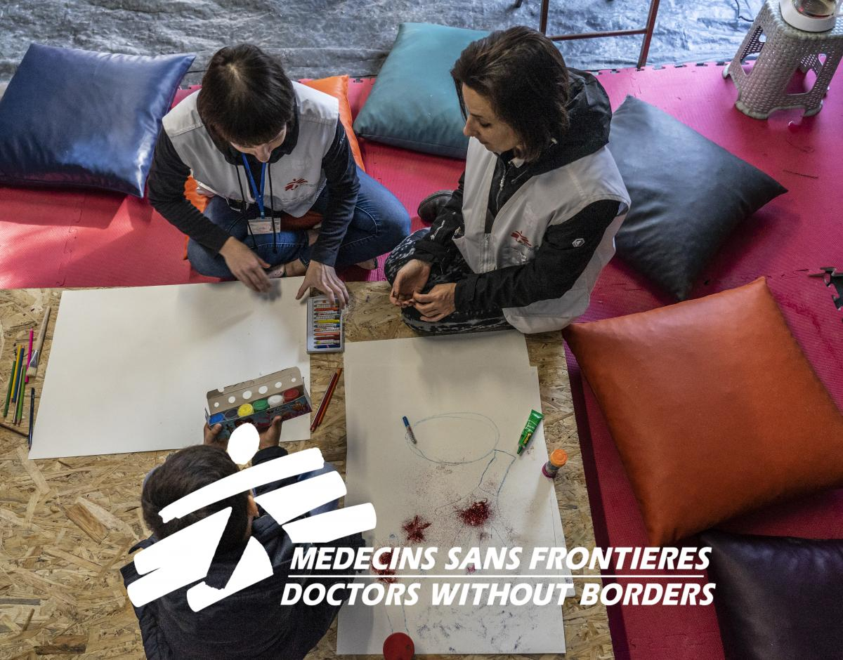 MSF psychologist and a cultural mediator in session with a minor from Afghanistan during a mental health consultation outside Moria camp.